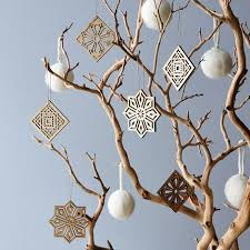 laser cut walnut ornaments on food52