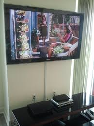 home theater wire concealment tv installation with the wires concealed in wire molding stem tv