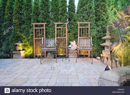 garden paver patio with trellis japanese stone lantern pagoda and