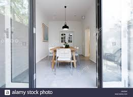 looking into contemporary scandi styled dining room through french