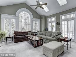 traditional living room with french doors u0026 transom window in