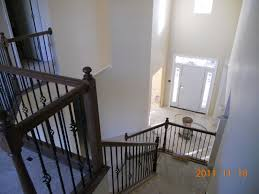brick work complete stair railing installed and trim work in