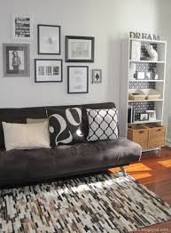futon living room studio apartment love the pillow and colors home is where the