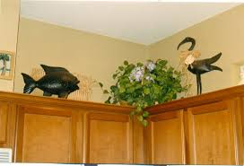 decorating ideas for space above kitchen cabinets how to image of decorate above kitchen cabinets ideas