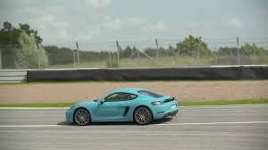 miami blue porsche 718 2017 porsche 718 cayman s miami blue full throttle on racetrack