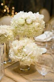 white flower centerpieces rehearsal dinner floral arrangements of white in silver vases