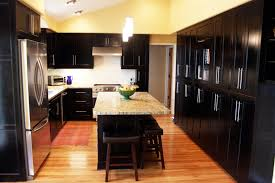 high cabinets for kitchen black kitchen cabinets with butcher block countertops in glancing