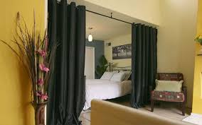 How To Divide A Room With Curtains by Roomdividersnow How To Divide A Room U0026 Create Privacy With A