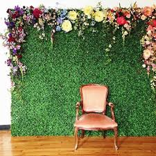 wedding backdrop green picture of a green wall with various colorful paper flowers for a