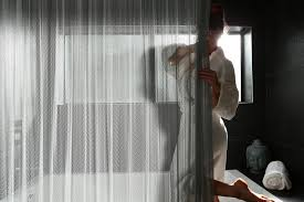 Shower Curtain To Window Curtain Cascade Coil Shower Curtains Provide Privacy And A Creative