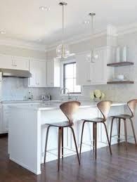 kitchen island peninsula 25 beautiful transitional kitchen designs pictures white quartz