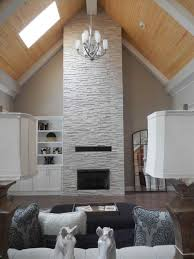 thin ledge stone rustic vaulted ceiling living room beams silver