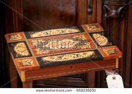 wood inlay antique italian wood inlay table front stock photo 659239201