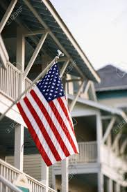 How To Hang The American Flag Vertically An American Flag Hanging From A Flagpole On The Front Of A Home