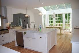 kitchen island with built in sink and seating