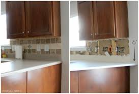 duo ventures kitchen makeover subway tile backsplash installation after some discussion decided continue the tile backsplash end quartz opposed ending upper cabinet