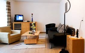 funiture small living room with black sofas and club chairs and