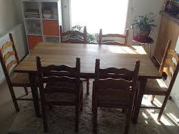 beautiful oak dining table and 6 wooden chairs with rattan style