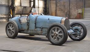 bugatti type 1 parade in paris caps fiva u0027s 50th anniversary celebration