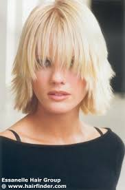 short chunky hairstyles medium hairstyle with chunky layers and a curved fringe
