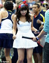 carly rae jepsen wears tennis whites and schoolgirl dress for