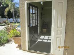 door retractable screen doors with black color and cream wall