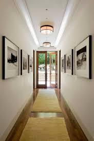 gray round fur rug on wooden floor hallway wall ideas gray