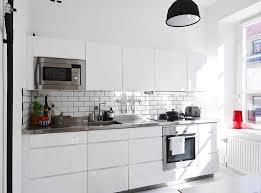 black white kitchen manuvactured stone countertops white kitchen cabinet white subway