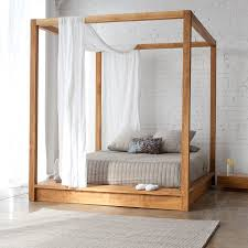 beautiful canopy bed design ideas with curtains that will make a simple minimalist wooden canopy bed design with grey low bed set and white silk curtains decorative