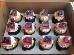 my little cupcake 12 regular size cupcakes 6 chocolate and 6 vanilla topped with vanilla buttercream plastic justice league rings and sprinkles