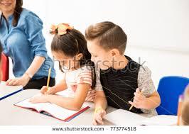 classmate copy caucasian preschooler trying copy work classmate stock photo