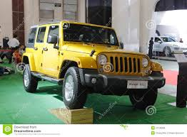 jeep yellow yellow jeep wrangler car editorial stock image image 42138369