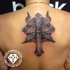 black diamond tattoo glyfada black diamond tattoo on twitter celtic symbolic cross cross
