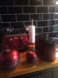 red kitchen accessories including toaster canisters candle