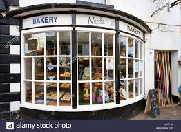 bow window stock photos bow window stock images alamy georgian bow window of a bakers shop in winchcombe in the cotswolds uk stock image