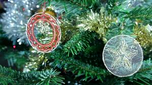 up of two lace tree decorations a white roundel