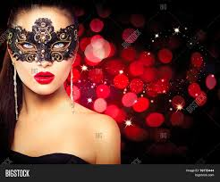 halloween masquerade background model woman in venetian masquerade carnival mask at party