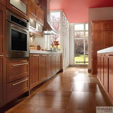 cherry cabinetry in kraftmaid u0027s cinnamon stain adds warmth to this