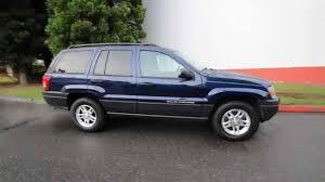 light blue jeep cherokee 2004 jeep grand cherokee laredo midnight blue 4c116528