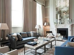 yellow walls curved sofa wood mantel light maple floors modern