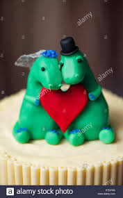 grooms cake toppers dinosaur and groom cake toppers on a wedding cake stock
