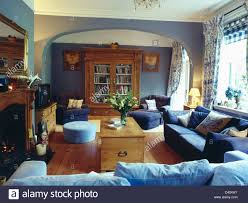 Dark Blue Living Room by Pale Blue And Dark Blue Sofas And Pine Chest In Pale Blue Living