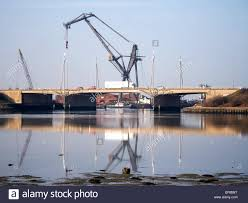 a canute crane in pounds scrapyard towers above the m275 at the