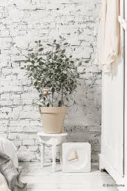 pastel bedroom decoration styled with a white brick wall