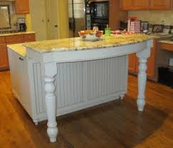 kitchen remodel features island posts and cabinet feet osborne
