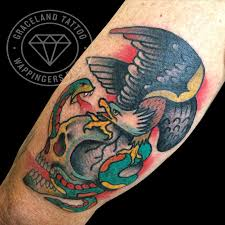 traditional skull eagle and snake by adam lauricella