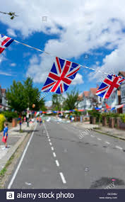 bunting and union jack british flags at a street party event with