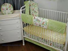 grey and tan crib bedding set for a gender neutral nursery with