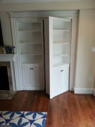 hidden bookcase door traditional family room philadelphia