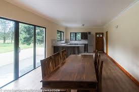 Patio Braai Designs Forest Cottage Open Plan Living Area Kitchen With Sliding Doors